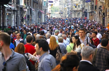 ISTANBUL, TURKEY - MAY 5: People walking on Istiklal Street on May 5, 2012 in Istanbul, Turkey. It is the most famous street in Istanbul, visited by nearly 3 million people in a single weekends day; Shutterstock ID 148074182
